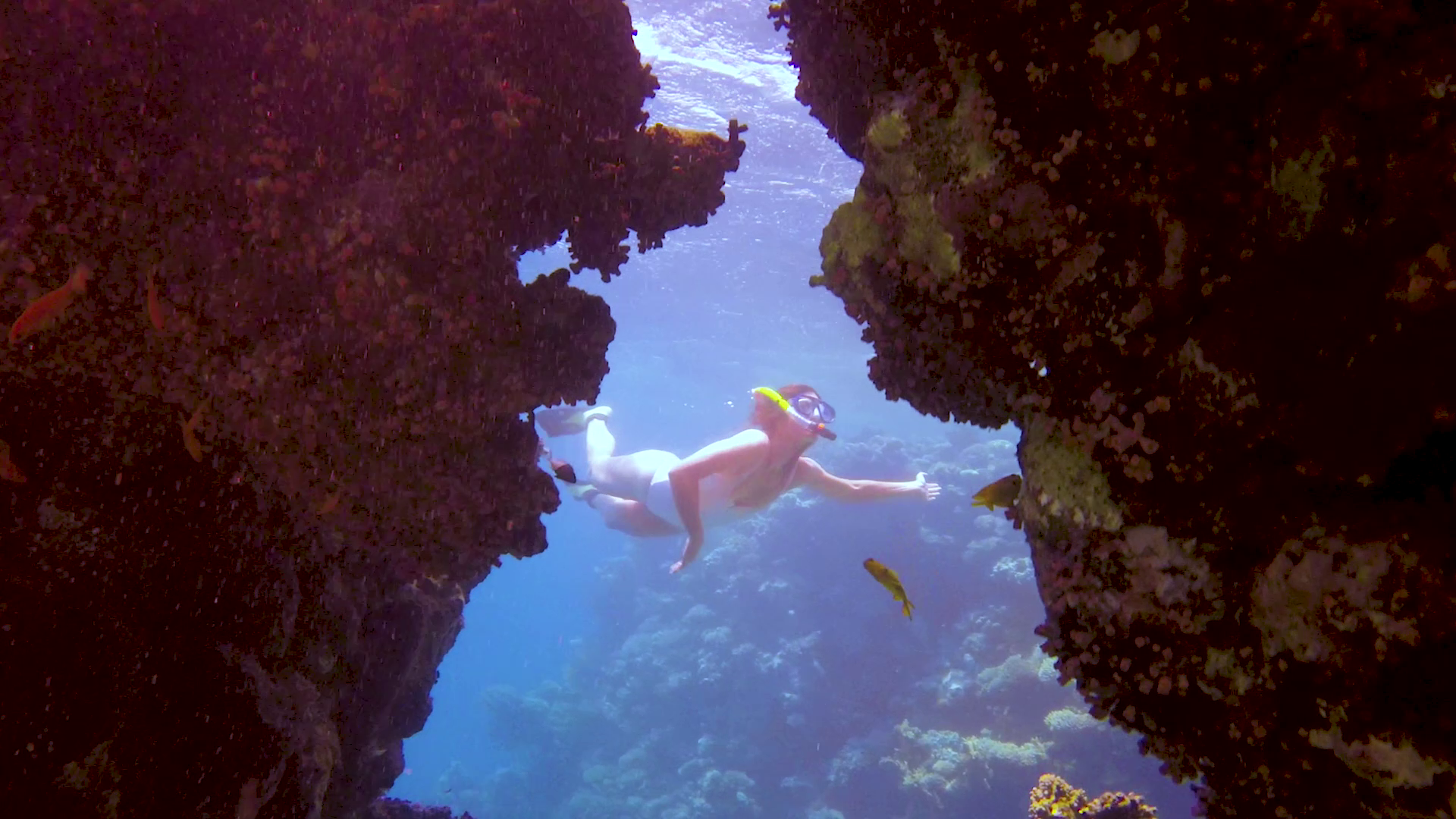 Girl diving in a cave in the red sea in Egypt